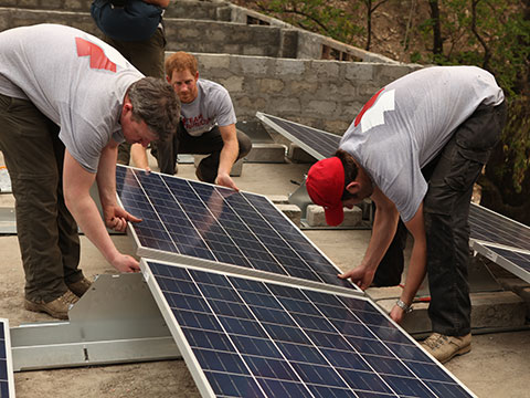Prince Harry helping to install solar panel